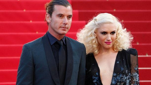 Singer Gwen Stefani (R) and her husband musician Gavin Rossdale.