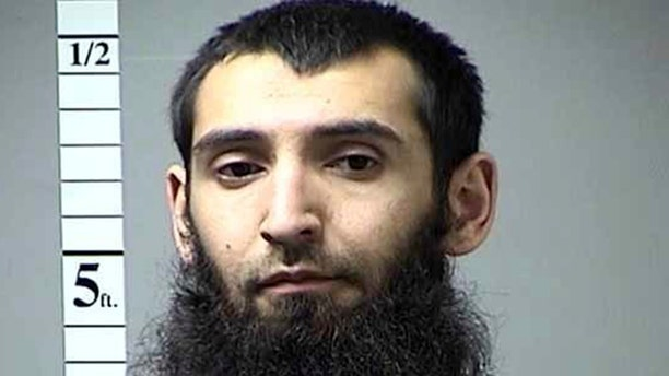This undated photo provided by St. Charles County Department of Corrections via KMOV shows the Sayfullo Saipov. A man in a rented pickup truck mowed down pedestrians and cyclists along a busy bike path near the World Trade Center memorial on Tuesday, Oct. 31, 2017, killing several. Officials who were not authorized to discuss the investigation and spoke on the condition of anonymity identified the attacker Saipov. (St. Charles County Department of Corrections/KMOV via AP)