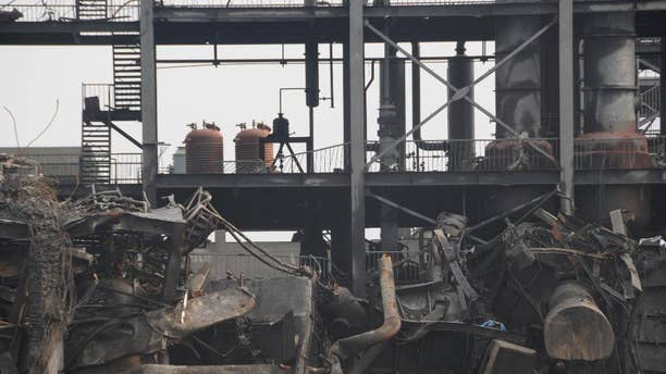 This photo released by China's Xinhua News Agency, shows a chemical factory after an explosion in Lijin county, east China's Shandong province Wednesday, Sept. 2, 2015. The factory that produces adhesive materials exploded on Monday night and the cause of the blast is still under investigation. (Lou Chen/Xinhua via AP) NO SALES