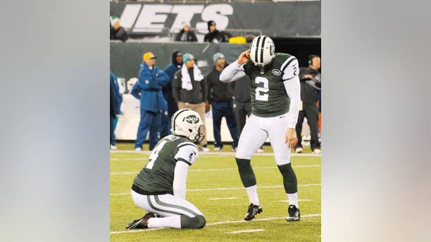 New York Jets kicker Nick Folk (2) reacts after missing a field goal against the Miami Dolphins during the second quarter of an NFL football game, Monday, Dec. 1, 2014, in East Rutherford, N.J. (AP Photo/Bill Kostroun)