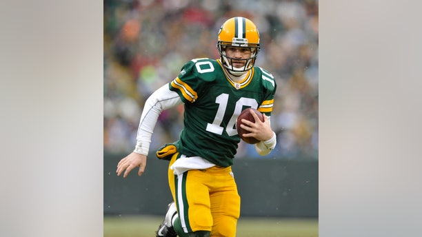 In this Jan. 1, 2012, photo, Green Bay Packers' Matt Flynn scrambles during an NFL football game against the Detroit Lions in Green Bay, Wis. With quarterback Aaron Rodgers hurt, Flynn will back up one-time practice squad player Scott Tolzien, who replaced Seneca Wallace in the 27-13 loss Sunday, Nov. 10, to the Eagles. (AP Photo/Mike Roemer)