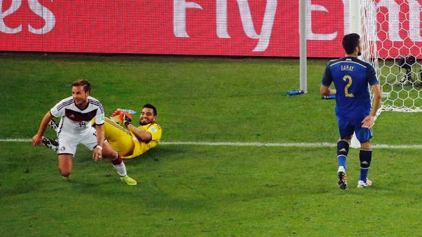 Germany's Mario Goetze celebrates past Argentina's goalkeeper Sergio Romero after scoring his side's first goal during the World Cup final soccer match between Germany and Argentina at the Maracana Stadium in Rio de Janeiro, Brazil, Sunday, July 13, 2014. (AP Photo/Fabrizio Bensch, Pool)