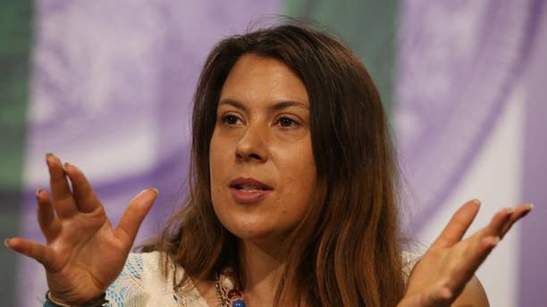 2013 Wimbledon champion Marion Bartoli of France attends a press conference at the All England Lawn Tennis Championships in Wimbledon, London,  Sunday June 22, 2014.  The Championships start Monday June 23. (AP Photo/AELTC, Scott Heavey)