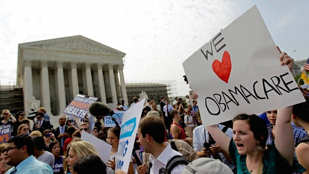 FILE: June 28, 2012: Supporters of President Barack Obama's health care law celebrate outside the Supreme Court in Washington, D.C.