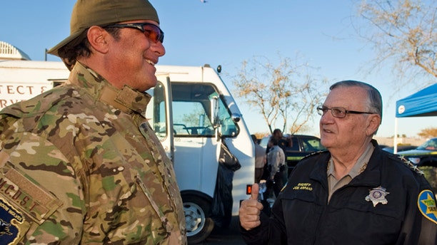 Maricopa County Sheriff Joe Arpaio, right, talks with actor Steven Seagal, who was visiting the sheriff.
