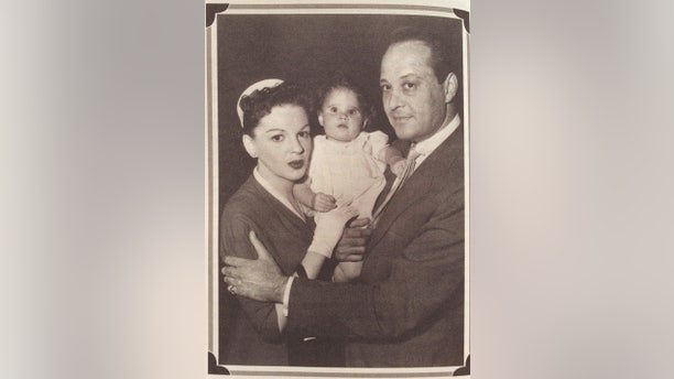 """Lorna Luft as a baby with her mother, Judy Garland and father, Sid Luft on the set of """"A Star Is Born."""""""
