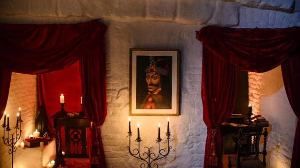 In this picture taken Oct. 9, 2016, a portrait of Vlad the Impaler is hung on a wall in Bran Castle, in Bran, Romania. (AP Photo/Andreea Alexandru)