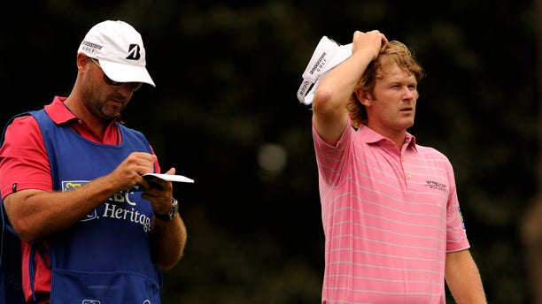 Brandt Snedeker, right, plans his tee shot on the 17th hole during the second round of the RBC Heritage golf tournament in Hilton Head Island, S.C., Friday, April 19, 2013. (AP Photo/Stephen Morton)