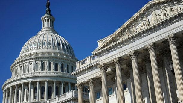 FILE -- August 2, 2011. The U.S. Capitol dome and U.S. Senate (R) in Washington. (Reuters)