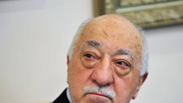 FILE - In this July 2016 file photo, Islamic cleric Fethullah Gulen speaks to members of the media at his compound, in Saylorsburg, Pa. Turkey's justice minister on Thursday, Oct. 27, 2016, pressed the U.S. to extradite Gulen who he accuses of orchestrating the July failed coup attempt or risk seriously harming relations between the two countries.  (AP Photo/Chris Post, File)