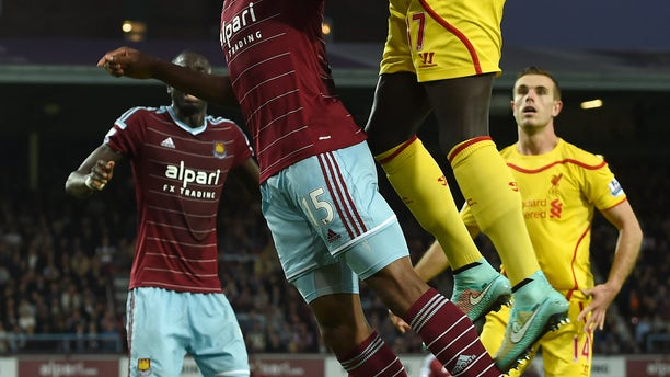 West Ham United's Diafra Sakho, left, competes for the ball with Liverpool's Mamadou Sakho during their English Premier League soccer match at Upton Park, London, Saturday, Sept. 20, 2014. (AP Photo/Tim Ireland)