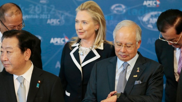 Sept. 9, 2012: Leaders pictured from left, Philippines President Benigno Aquino III, Japanese Prime Minister Yoshihiko Noda, U.S. Secretary of State Hillary Rodham Clinton, Malaysian Prime Minister Najib Razak  and Taiwanese Special Envoy Lien Chan gather for the leaders group photo on the final day of the APEC summit in Vladivostok, Russia.