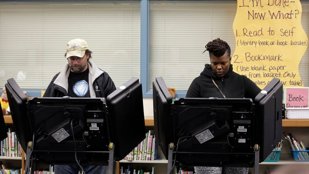 April 7, 2015: Rich Baranowski, left, and Tracy Hardy vote in Ferguson's municipal election, in Ferguson, Mo. (AP Photo/Jeff Roberson)