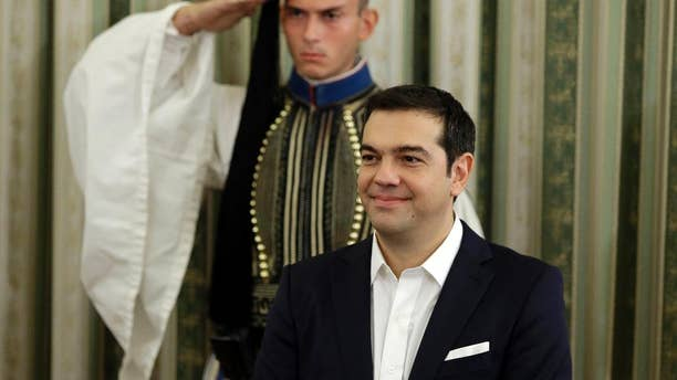 Greece's Prime Minister Alexis Tsipras attends his cabinet's swearing in ceremony at the presidential palace in Athens, Wednesday, Sept. 23, 2015. Despite leftwing leader Alexis Tsipras' policy U-turn, he was re-elected by a wide margin in last weekend's general election, and again formed a coalition government with a small right-wing party, the Independent Greeks. (AP Photo/Thanassis Stavrakis)