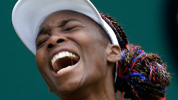 Venus Williams of the United States screams during her match against Aleksandra Wozniak of Canada at the All England Lawn Tennis Club in Wimbledon, London at the 2012 Summer Olympics, Tuesday, July 31, 2012. (AP Photo/Elise Amendola)