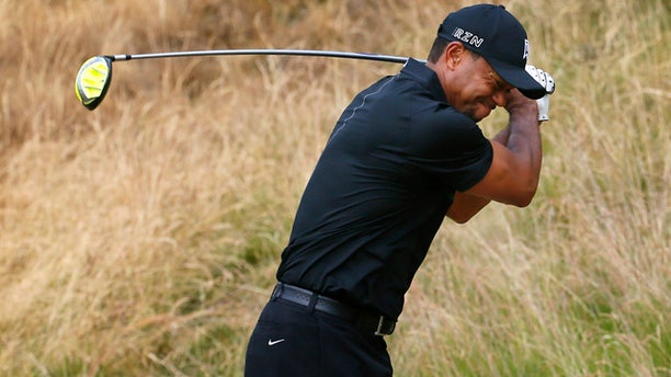 June 18, 2015: Tiger Woods reacts to his tee shot on the eighth hole during the first round of the U.S. Open golf tournament at Chambers Bay in University Place, Wash. (AP Photo/Matt York)