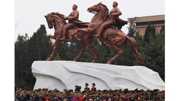 Feb. 14,2012- North Koreans leave the grounds of the Mansudae Art Studio in Pyongyang after watching the unveiling of a new bronze statue depicting the late leader Kim Jong Il and his father Kim Il Sung. As North Koreans prepare for what would have been the 70th birthday of late leader Kim Jong Il this week, the country's state media have gone to great lengths to build up the man who led the nation for 17 years until his death in December.