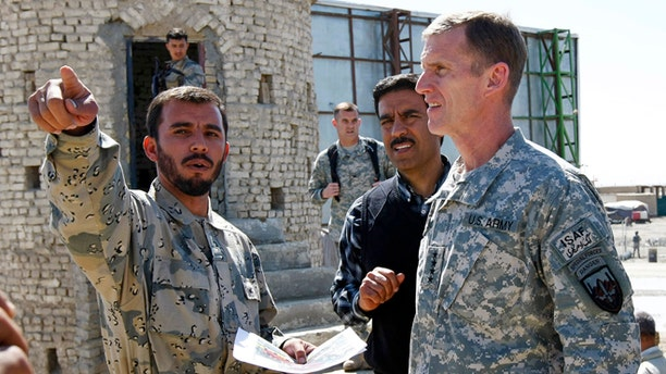 Warlord and Afghan border police Commander Colonel Abdul Razziq, seen here with General Stanley McChrystal in 2010, is believed to earn a major cut  from all trucking that passes through the Spin Boldak region.