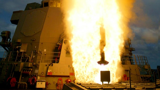 In an undated photo supplied by Lockheed Martin, an Aegis-equipped destroyer launches an intercept missile. The missile defense system is intended to intercept and destroy short- and medium-range ballistic missiles.