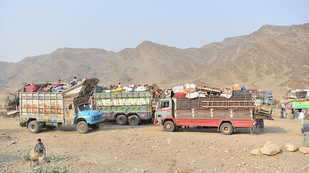 Trucks carrying the belongings of returnees from Pakistan line up at the returnee center, near the Afghan-Pakistan border.
