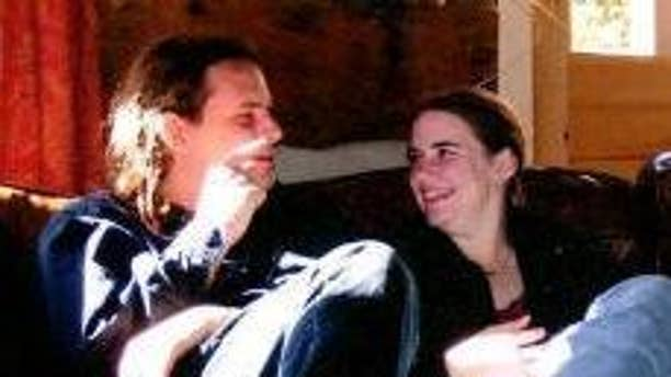 In this undated photo provided by James Coleman, Caitlan Coleman, right, sits with her husband, Josh. Caitlan Coleman's family has broken months of silence over her mysterious disappearance.