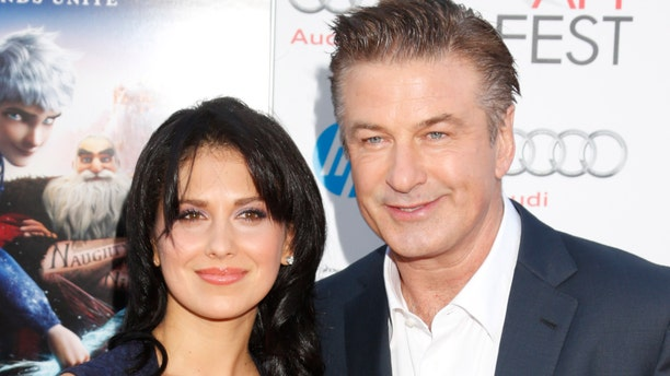 """FILE - This Nov. 4, 2012 file photo shows actor Alec Baldwin, right, and his wife Hilaria Thomas at the """"Rise Of The Guardians'"""" special screening during the 2012 AFI FEST at Grauman's Chinese Theatre in the Hollywood section of Los Angeles. A possible plea deal in New York for Genevieve Sabourin, a Canadian actress accused of stalking Alec Baldwin has been postponed. Police originally arrested Sabourin after authorities said she had implored Baldwin to see and to marry her in emails sent only days after he became engaged to yoga instructor Hilaria Thomas. She later spent a night in jail after she was accused of sending Thomas a Twitter message. (Photo by Todd Williamson/Invision/AP, file)"""
