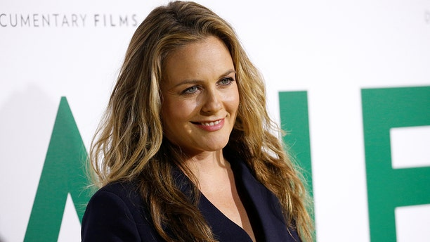 """Actor Alicia Silverstone poses at the premiere for the documentary """"Jane"""" in Los Angeles, California, U.S., October 9, 2017. REUTERS/Mario Anzuoni - RC1503DF5320"""
