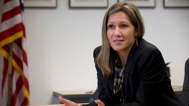 In this photo taken April 30, 2014, Amanda Renteria is interviewed in Washington.