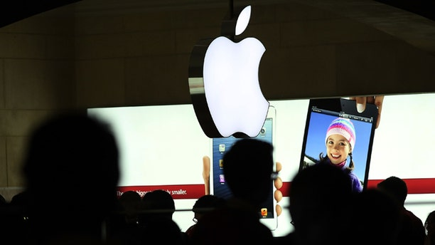 NEW YORK, NY - DECEMBER 10: People walk through the Apple retail store in Grand Central Terminal on December 10, 2012 in New York City. Apple Inc. stock was down $4.56 per share, or 0.86 percent decline as investors and analysts worry that the U.S market is becoming saturated with apple products. Apple, the world's most valuable publicly traded company, has lost $167 billion in market value in less than three months.  (Photo by Spencer Platt/Getty Images)