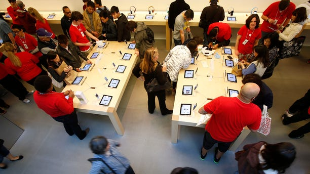 File photo. Holiday shoppers shop at the Apple Store during Black Friday in San Francisco, California, November 23, 2012. John R. Quain has some more unconventional tech gift choices this holiday season.