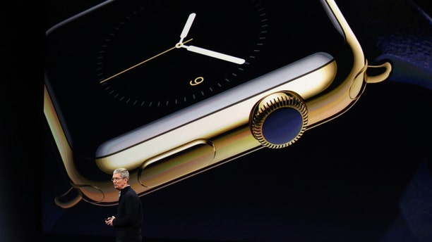 Apple CEO Tim Cook introduces the Apple Watch during an Apple event in San Francisco, California March 9, 2015.