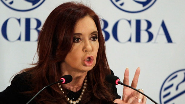 FILE - In this Aug. 2, 2012 file photo, Argentina's President Cristina Fernandez speaks at an event marking the 158 anniversary of the stock exchange in Buenos Aires, Argentina. The South American country has until midnight Friday, March 29, 2013 to propose how it would satisfy a $1.4 billion judgment won by plaintiffs in U.S. courts who have insisted for a decade on getting full payment in cash, plus interest and penalties, on sovereign debt that the country hasn't paid since its world-record default in 2002. Fernandez's government is reportedly preparing a response that analysts say could lead the country into another catastrophic default. (AP Photo/Eduardo Di Baia, File)