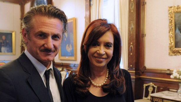 """In this picture released by Argentina's Presidency, President Cristina Fernandez poses with actor Sean Penn at government palace in Buenos Aires, Argentina, Monday Feb. 13, 2012. Penn, who is taking Argentina's side in the Falkland Islands dispute, urged Britain to join U.N.-sponsored talks over what he called """"the Malvinas Islands of Argentina."""" (AP Photo/Argentina's Presidency)"""