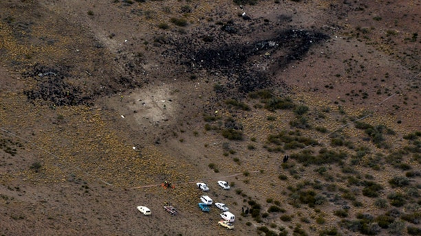 May 19: Firefighters inspect the debris of a plane that crashed and exploded in Argentina's southern Patagonia region killing all 22 on board and disintegrating in the air.