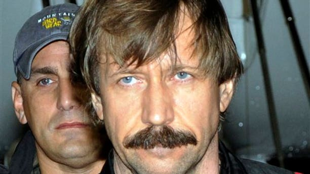 FILE - This Tuesday Nov. 16, 2010 file photo provided by the Drug Enforcement Administration shows Russian arms trafficker Viktor Bout in U.S. custody after being flown from Bangkok to New York.