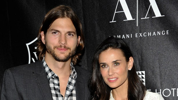"An industry source told People Demi Moore, right, ""was confused about her life and what direction her career would take as she got older"" after split from Ashton Kutcher, left."
