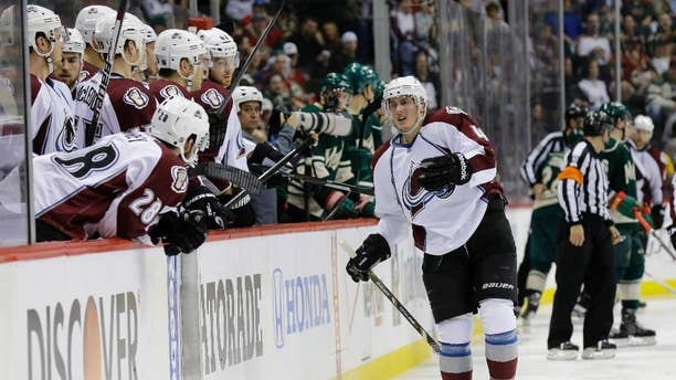 Colorado Avalanche defenseman Tyson Barrie, right, leaves the ice after getting injured on a hit by Minnesota Wild left wing Matt Cooke during the second period of Game 3 of an NHL hockey first-round playoff series in St. Paul, Minn., Monday, April 21, 2014. The Wild won 1-0 in overtime. (AP Photo/Ann Heisenfelt)