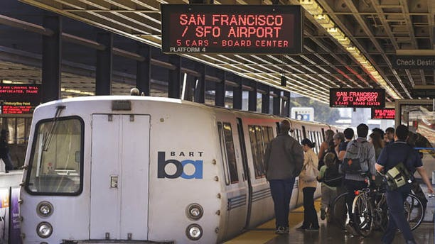 October 15, 2013: Passengers board a Bay Area Rapid Transit train Tuesday in Oakland, Calif. (AP Photo)
