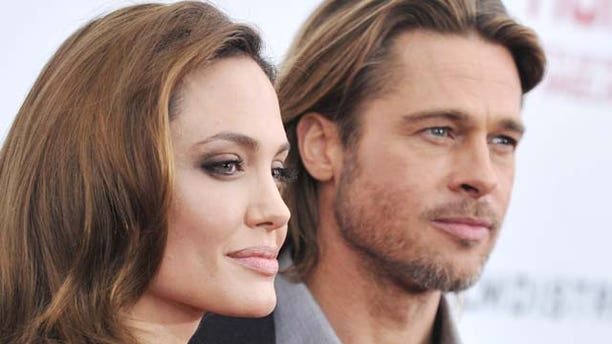 """Dec. 5, 2011:  Angelina Jolie and Brad Pitt attend the premiere of """"In the Land of Blood and Honey"""" at the School of Visual Arts in New York City."""