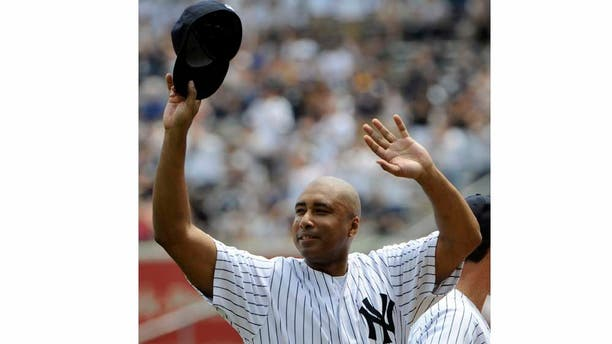 Former New York Yankees center fielder Bernie Williams reacts to applause during Old Timers' Day ceremonies on Sunday, June 26, 2011, at Yankee Stadium in New York.