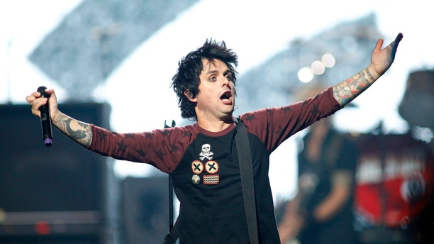 Green Day lead vocalist and guitarist Billie Joe Armstrong performs during the 2012 iHeart Radio Music Festival at the MGM Grand Garden Arena in Las Vegas, Nevada September 21, 2012.