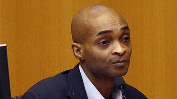 Apr. 9: Anthony Hopkins, 39, testifies during his trial in Circuit Judge John Lockett's courtroom at Mobile Government Plaza in Mobile, Ala. Hopkins was sentenced on May 20 to life plus 51 years in prison after being convicted of killing his wife and storing her body in a home freezer in 2004.
