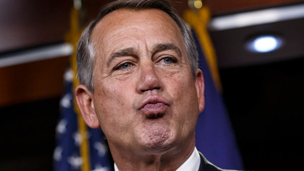 Feb. 26, 2015: House Speaker John Boehner responds to reporters about the impasse over passing the Homeland Security budget because of Republican efforts to block President Obama's executive actions on immigration.
