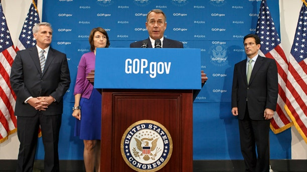 FILE: Sept. 10, 2013: House Speaker John Boehner, flanked by his leadership team on Capitol Hill, in Washington, D.C.