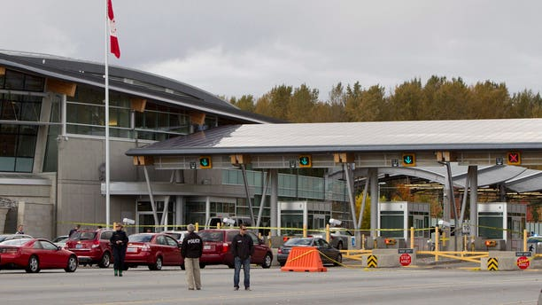Oct. 16, 2012: Police investigate the scene of a shooting at the Blaine, Wash./Surrey, British Columbia border crossing in Surrey.