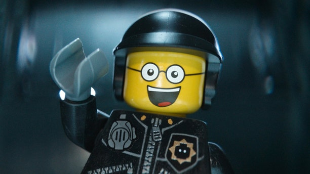 """This image released by Warner Bros. Pictures shows the character Bad Cop/Good Cop, voiced by Liam Neeson, in a scene from """"The Lego Movie."""" The Lego Movie is expected to take the top spot at the box office in its second weekend. (AP Photo/Warner Bros. Pictures, file)"""