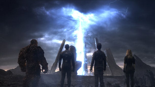 This photo provided by Twentieth Century Fox shows, The Thing, from left, Michael B. Jordan as Johnny Storm, Miles Teller as Dr. Reed Richards, and Kate Mara as Sue Storm, in a scene from the film 'Fantastic Four'. (Twentieth Century Fox via AP)
