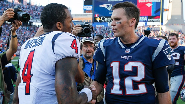 New England Patriots quarterback Tom Brady greets Houston Texans quarterback Deshaun Watson after their game in Foxborough, September 24, 2017.