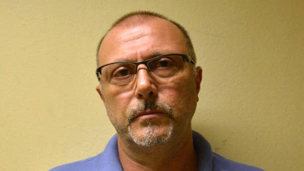 May 26, 2015: This photo released by Brazil's Federal Police shows Italian Pasquale Scotti, after his arrest in Recife, Brazil.