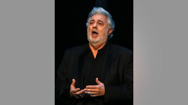 """FILE - In this May 1, 2013 file photo, Placido Domingo performs Siegmund's aria in """"The Valkyrie,"""" during a pre-premiere performance, in St. Petersburg, Russia. The Spanish tenor has given a concert during nearly every single World Cup since 1990 and is gearing up for a July 11, 2014 presentation in Rio de Janeiro, just two days before the city hosts the final game. (AP Photo/Dmitry Lovetsky, File)"""